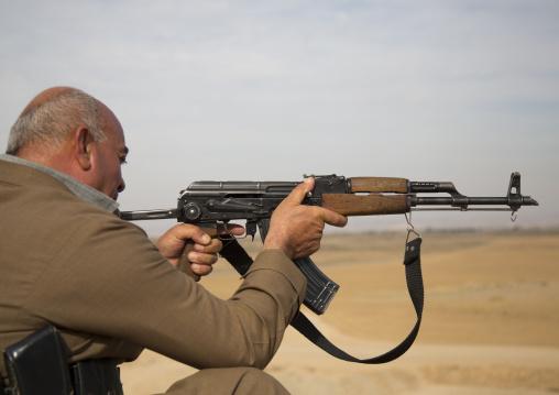 Kurdish Peshmerga Veteran Shooting On The Frontline, Kirkuk, Kurdistan, Iraq