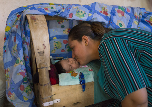Yazidi Mother Kissing Her Baby In The Temple City Of Lalesh, Kurdistan, Iraq