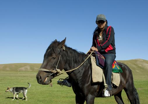 Woman With Sunglasses Riding A Horse, Jaman Echki Jailoo Village, Song Kol Lake Area, Kyrgyzstan