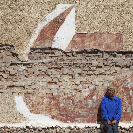 Woman Sitting On A Dilapidated Wall, Song Kol Lake Area, Kyrgyzstan