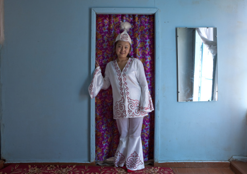 Woman Wearing Traditional Clothes And Headgear, Village Of Kyzart, Kyrgyzstan