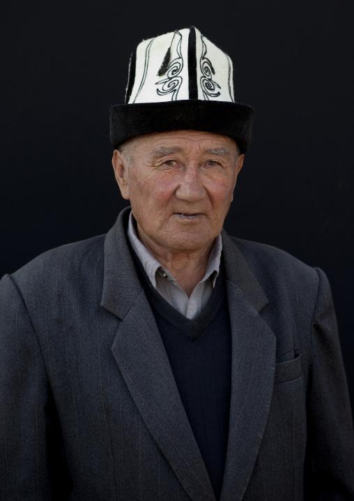 Old Man With A Kalpak Hat At The Animal Market In Kochkor, Kyrgyzstan