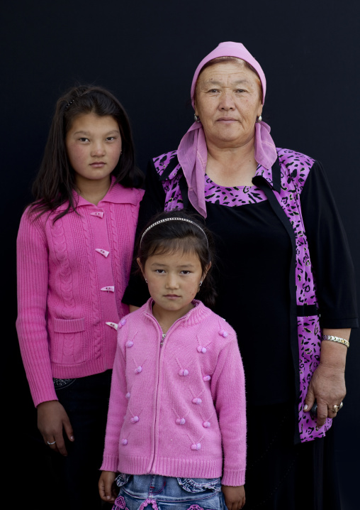 Woman With Headscarf And Girls At The Animal Market Of Kochkor, Kyrgyzstan