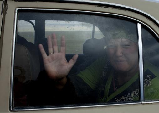Woman Inside A Car Waving, Saralasaz Jailoo, Kyrgyzstan