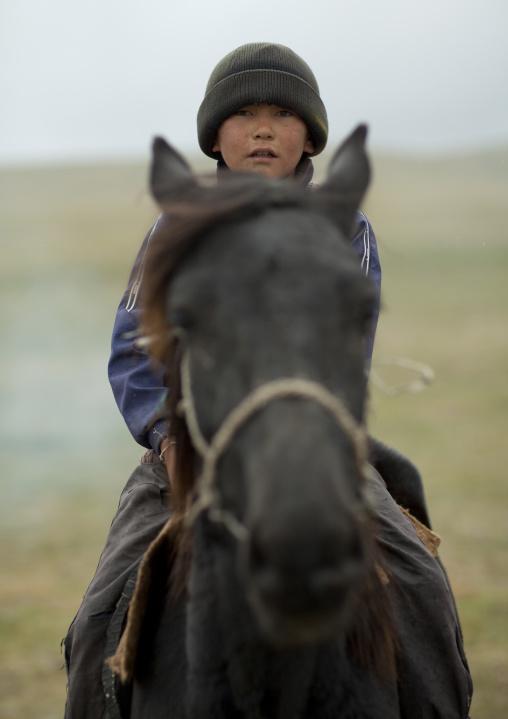 Boy With Wooly Riding A Horse, Saralasaz Jailoo, Kyrgyzstan