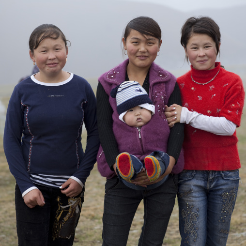 Women And Baby In Saralasaz Jailoo, Kyrgyzstan