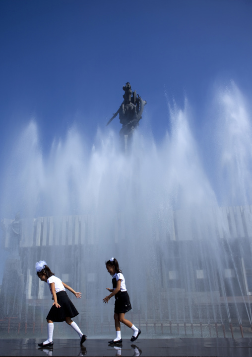 Girls In School Uniform Having Fun In A Fountain, Bishkek, Kyrgyzstan