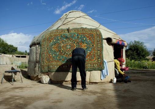 Couple Preparing Their Yurt For Funerals, Kochkor, Kyrgyzstan