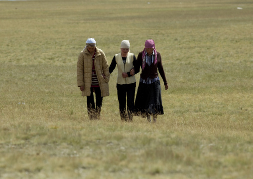 Women With Headscarves Walking In The Steppe, Song Kol Lake Area, Kyrgyzstan