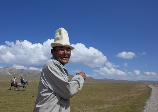 Old Man With Kalpak Hat Enjoying The Horse Game, Song Kol Lake Area, Kyrgyzstan