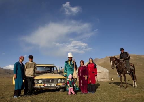 Family Gathered In Front Of Their Yurt And Car, Jaman Echki Jailoo Village, Song Kol Lake Area, Kyrgyzstan