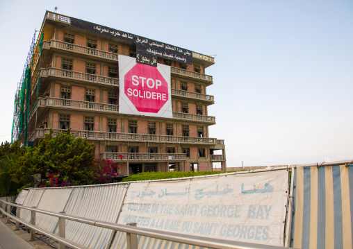 A sign at the abandonned saint george hotel protesting against the reconstruction project and the Solidere company running it, Beirut Governorate, Beirut, Lebanon