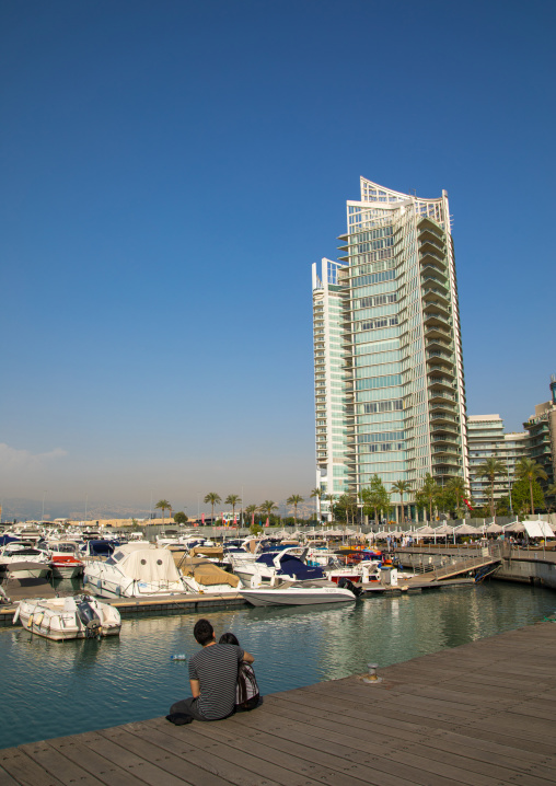 Couple in front of luxury residential buildings on the corniche, Beirut Governorate, Beirut, Lebanon