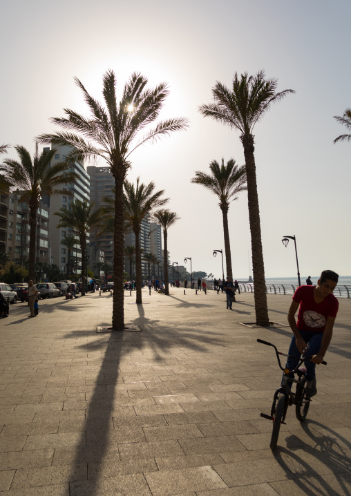 Lebanese man on a bicycle in the corniche, Beirut Governorate, Beirut, Lebanon