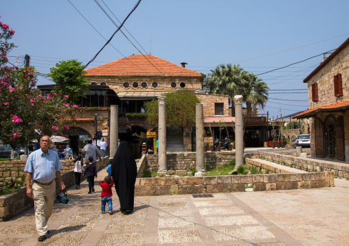 Tourists in  front of antique coloumns in the historic town, Mount Lebanon Governorate, Byblos, Lebanon