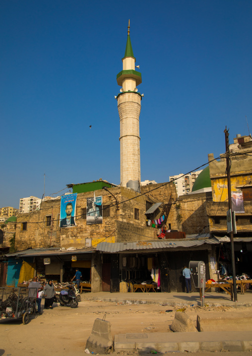 Mosque minaret in the middle of residential apartments and housing, North Governorate, Tripoli, Lebanon