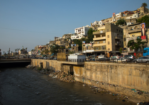Polluted river crossing residential apartments and housing, North Governorate, Tripoli, Lebanon