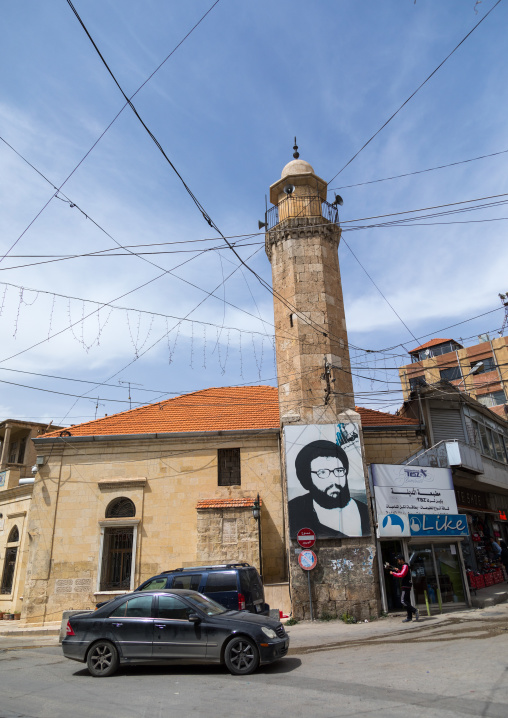 Mosque with the giant portrait of abbas al-musawi an hezbollah martyred leader, Beqaa Governorate, Baalbek, Lebanon
