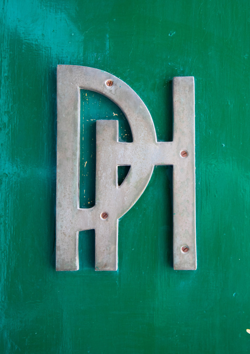 Palmyra hotel logo on the green entrance door, Beqaa Governorate, Baalbek, Lebanon