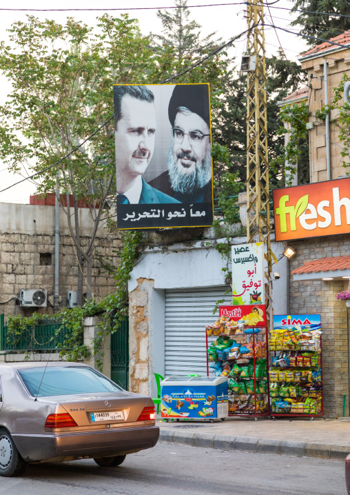 Bashar Al-Assad and Hassan Nasrallah portraits in the street, Beqaa Governorate, Baalbek, Lebanon