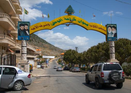 Gate depicting the Hezbollah and iranian leaders, Beqaa Governorate, Machghara, Lebanon
