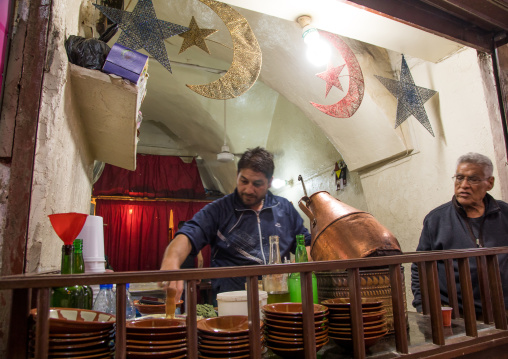 Man cooking beans to make foul for breakfast in a restaurant, South Governorate, Tyre, Lebanon