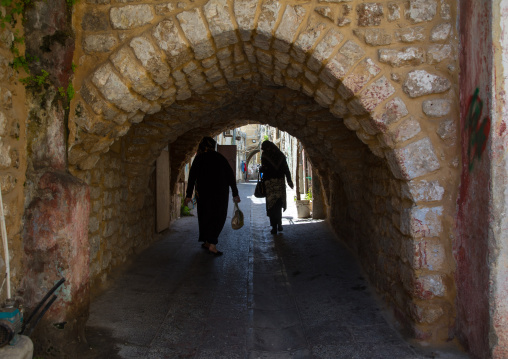 Women passing thru an arch in the old town, South Governorate, Tyre, Lebanon