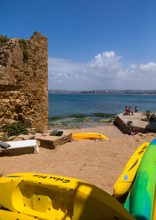 People sunbathing on a beach near a ruin, South Governorate, Tyre, Lebanon