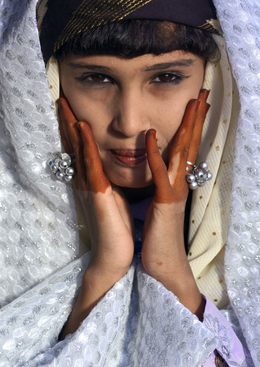 Tuareg girl in traditional clothing with henna on the hands, Tripolitania, Ghadames, Libya