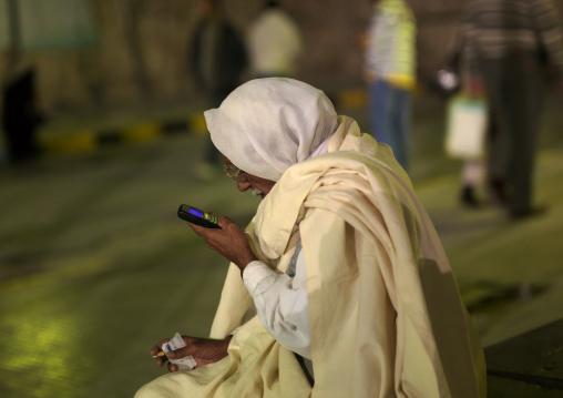Old man reading texts on his mobile phone, Tripolitania, Tripoli, Libya
