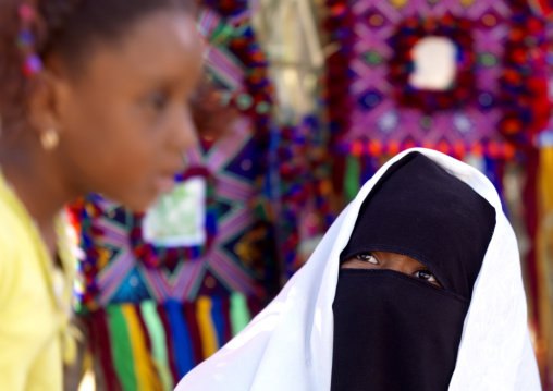 Woman in burqa with her daughter, Tripolitania, Ghadames, Libya