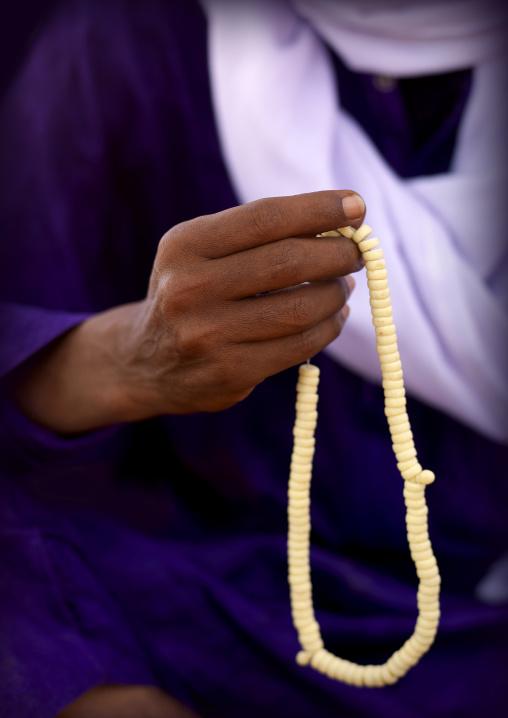 Tuareg man praying with beads, Fezzan, Umm al-Maa, Libya