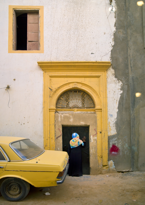 Yellow car parked in the medina in front a door, Tripolitania, Tripoli, Libya