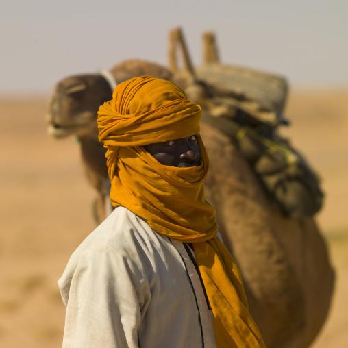 Portrait of a tuareg man with his camel, Tripolitania, Ghadames, Libya