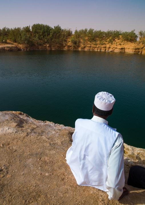 Man watching a lake in the desert, Tripolitania, Ghadames, Libya