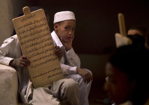 Children in a coranic school with a wooden board, Tripolitania, Ghadames, Libya