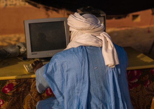 Tuareg man using a computer, Tripolitania, Ghadames, Libya