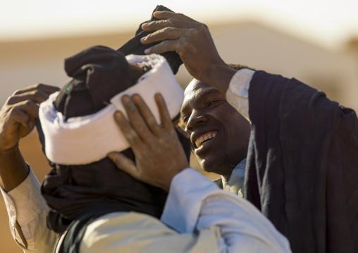 Tuareg man putting turban, Tripolitania, Ghadames, Libya