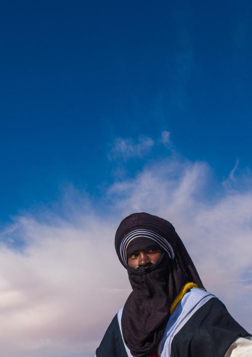Portrait of a tuareg man  in traditional clothing against the sky, Tripolitania, Ghadames, Libya