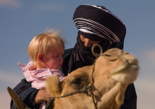 Portrait of a tuareg man with a blonde western girl, Tripolitania, Ghadames, Libya