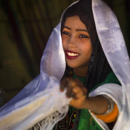 Smiling tuareg girl in traditionnal clothing, Tripolitania, Ghadames, Libya