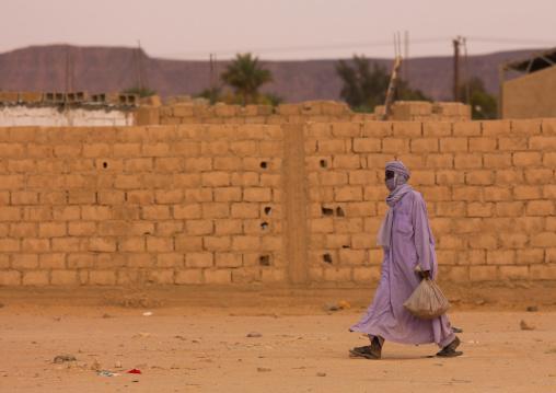 Tuareg man walking in the street, Tripolitania, Ghadames, Libya