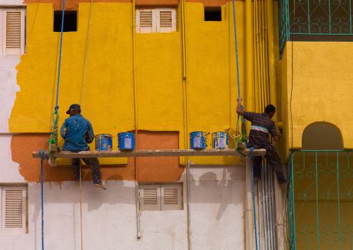Men painting an Italian colonial building, Cyrenaica, Benghazi, Libya