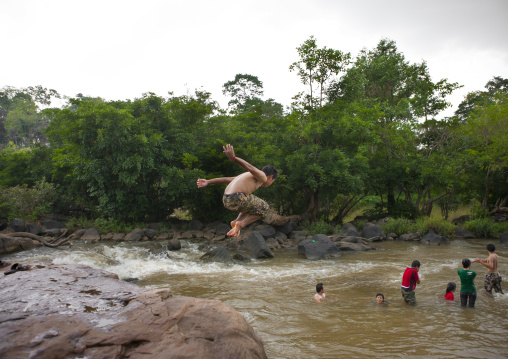 Kids jumping in tadfan waterfalls, Boloven, Laos