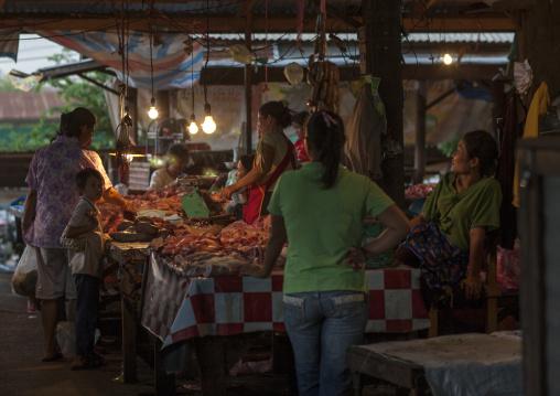 Butcher in a market, Phonsaad, Laos