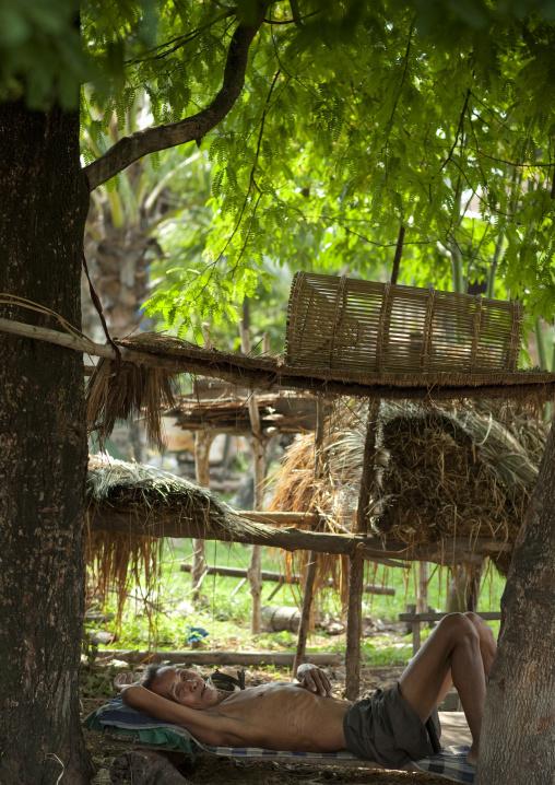 Bru minority old man resting, Phonsaad, Laos