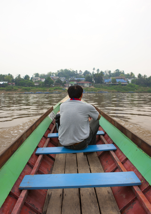 Man in a  speedboat on mekong river, Houei xay, Laos