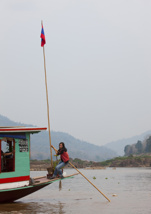 Woman on a boat on mekong river, Houei xay, Laos