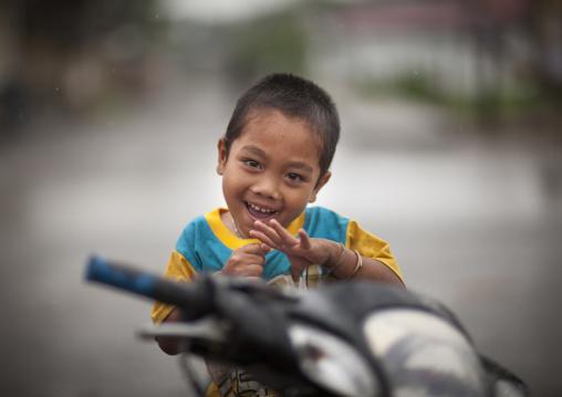 Smiling kid on a motorbike, Houei xay, Laos
