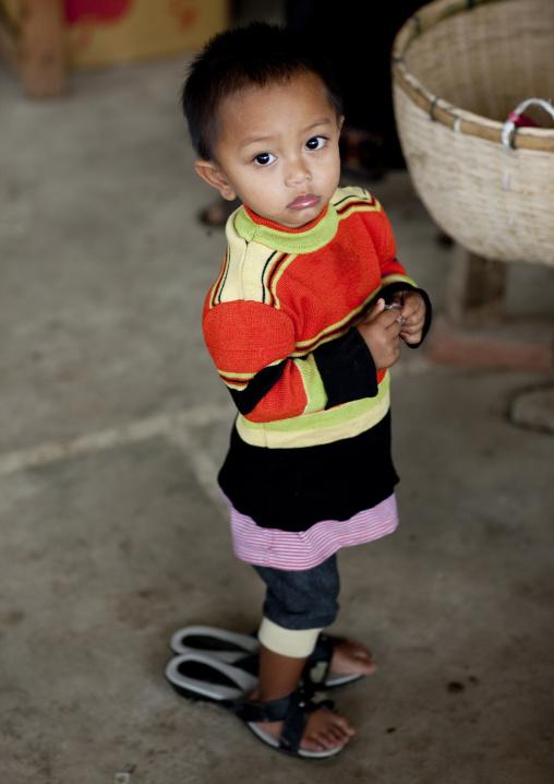 Khmu minority girl with big shoes, Xieng khouang, Laos